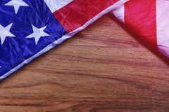 USA Flag on Brown Wooden Board Scene. USA Flag on Brown Wooden Board. America Flag Background with Copy Space for MLK Day, President`s Day, Patriot Day, 4th of Royalty Free Stock Image