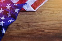 USA Flag on Brown Wooden Board Scene. USA Flag on Brown Wooden Board. America Flag Background with Copy Space for MLK Day, President`s Day, Patriot Day, 4th of Royalty Free Stock Images