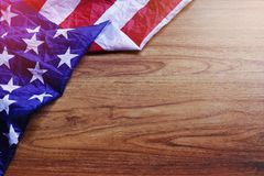 USA Flag on Brown Wooden Board Scene. USA Flag on Brown Wooden Board. America Flag Background with Copy Space for MLK Day, President`s Day, Patriot Day, 4th of Stock Photos