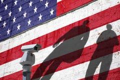 Usa flag with cctv and people shadows Stock Photo