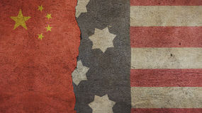 Usa Flag and China Flag. On Cracked Concrete Royalty Free Stock Image