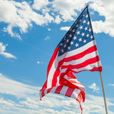 USA flag with clouds on background Royalty Free Stock Image