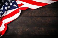 USA flag on wood background. USA flag on dark wood background royalty free stock image