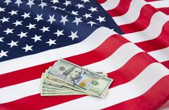 USA flag with dollars notes. American dream concept royalty free stock photography