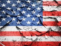 Usa flag on dry cracked earth. Texture royalty free stock photography