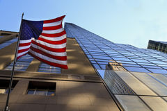 USA flag in the facade of a New York skyscraper Stock Images