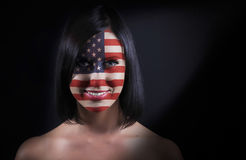 USA flag face. On a woman Royalty Free Stock Images
