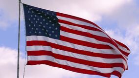USA flag on flagpole, super slow motion video shot