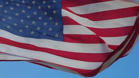 Close up of American flag waving. USA flag flaping in wind. Elegant Nylon American Flag Waving in the Wind. Close-up of an American flag flying in the wind stock video