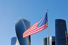 Usa flag fluttering on flagpole against the background of Moscow City. Skyscrapers royalty free stock photography