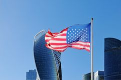 Usa flag fluttering on flagpole against the background of Moscow City. Skyscrapers royalty free stock images
