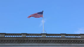 USA Flag. Flying at Top of Building stock video