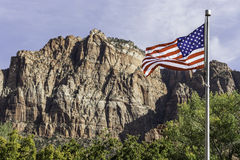 USA flag in front of mountains. Flag in the wind in front of mountains of zion national park usa Royalty Free Stock Photo