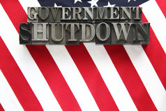 USA flag with government shutdown in metal type. The words government shutdown on an American flag Stock Photo