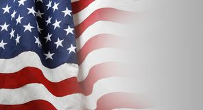 USA flag on grey. Closeup of American flag on grey background Stock Image