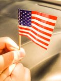 USA flag is held by a boy. United States of America flag hold by young boy Royalty Free Stock Photos