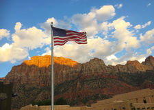 USA flag in landscape. With mountains and blue sky Stock Photo