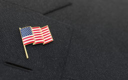 USA flag lapel pin on the collar of a suit Royalty Free Stock Photography