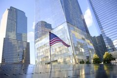 USA Flag at the 9/11 Memorial. NEW YORK, USA - September 29, 2017: Names of the victims and a USA Flag at the National September 11 Memorial, in New York, USA stock image