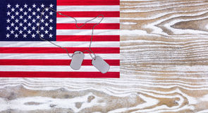 USA Flag and military ID tags on fade white wood background Royalty Free Stock Image