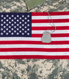 USA flag with military uniform and identification tags Stock Images