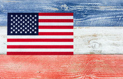 USA flag with national colors painted on fading wooden boards Royalty Free Stock Photo
