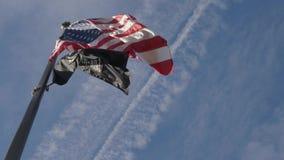 USA flag and National League of Families POW MIA Flag