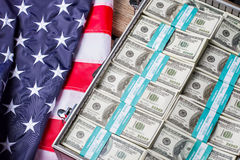 USA flag near dollar bundles. Stock Images