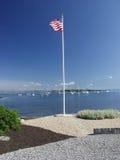 USA Flag over the Harbor Stock Photos