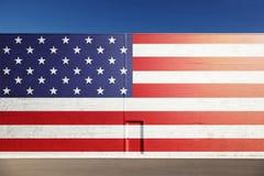 Usa flag painted on big metal wall with door Stock Photo