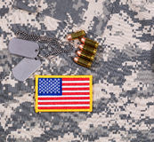 USA flag patch, ID tags, bullets on military battle dress unifor Royalty Free Stock Image