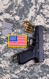 USA Flag patch on military uniform with weapon and ammo Stock Photography