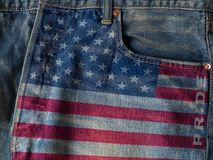USA flag with pride word on denim blue jeans background concept. stock images