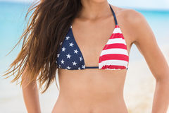 USA flag sexy bikini woman on beach vacation Stock Image