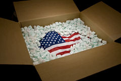 USA flag in shipping carton Stock Images