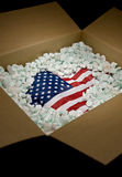 USA flag in shipping carton Royalty Free Stock Images