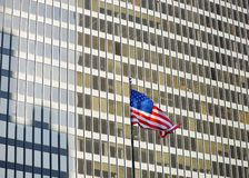 USA flag with skyscraper on background Royalty Free Stock Photo