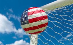 USA flag and soccer ball in goal net Royalty Free Stock Photo