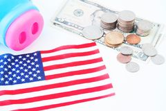 USA flag, stack of coins and dollars, Travel America concept Stock Photography
