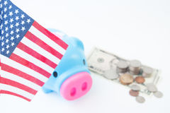 USA flag, stack of coins and dollars, Travel America concept Royalty Free Stock Photos