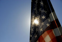 USA Flag with the Sun Behind Stock Images