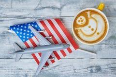 USA flag, toy plane and coffee. Stock Photo