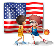 The USA flag and the two basketball players Royalty Free Stock Photography