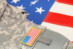 USA flag with US army uniform over it - studio shot Stock Photography