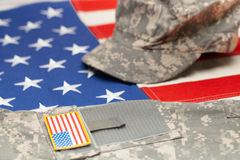 USA flag with US military uniform over it - studio shot stock photo