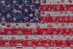 USA Flag through Water Droplets. The blue, red and white flag of the United States of America reflected through water droplets Stock Photography