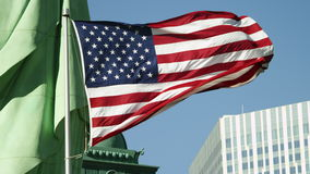 Usa flag waves in the foreground in New York stock video