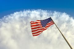 USA flag waving. In sunny day with beautiful cloud Stock Image