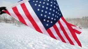 USA flag waving in the wind, highly detailed fabric texture. US flag on ski slope winter day stock video