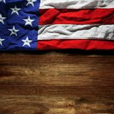 USA flag on wood. En background Royalty Free Stock Image
